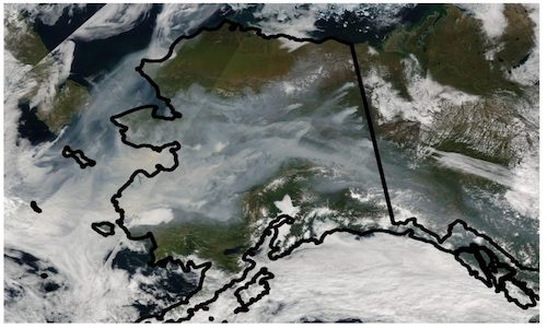 A satellite image of Alaska captured in August 2005 shows the extent of smoke coverage from wildfires in the state's boreal forests.